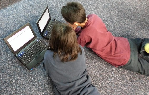 Boy and Girl Using Computers
